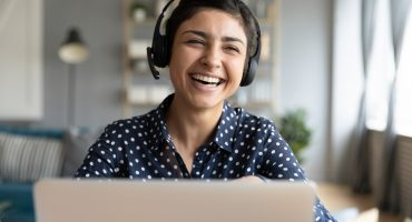 Woman laughing during an online meeting
